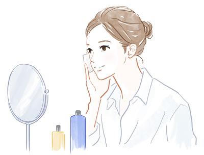 化粧品を使う女性の画像